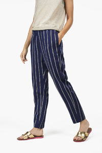 Pants Blanch 65% Acetate, 35% Cotton Pants made of slightly shiny Italian quality with woven stripes. Elastic waist with drawcord, French pockets at the sides, piped pockets at the back.  Relaxed fit Mid waist Tapered leg