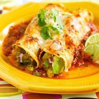 An avocado mixture fills the tortillas to make these enchiladas. A spicy beer and tomato mixture makes the sauce for this dinner casserole.