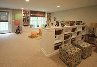 basement playroom, nicely finished with trim and storage areas