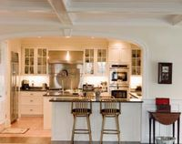 Opening up a kitchen wall can make your home more liveable, as the opening connects one of the main work spaces in your home with another part of your living sp