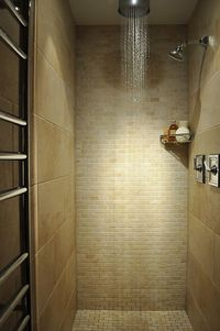 I like the tiling pattern 1 wall and floor with small tile and the other two walls with bigger tiles.