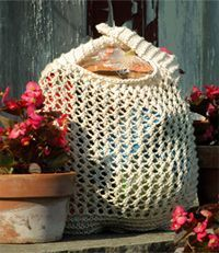 This free knit bag pattern is really cute you'll want to make it right away. It's great for holding your groceries or even your school books. Worsted weight yarn is used.