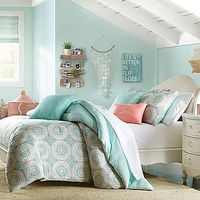 Beach style: Brighten up your bedroom with the lively Wendy Bellissimo Sunrise Reversible Comforter Set. Embellished with detailed medallions in hints of soft sea green, orange and white, the whimsical bedding brings an ornate look to any room's déco...