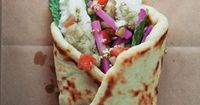 A common street food in Lebanon, manaeesh are flatbreads spread with various fillings, then folded over for easy eating. This recipe is based on one in Barbara