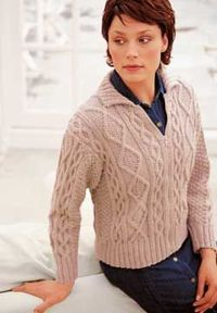 This zippered jacket knitting pattern features classic aran cables. This jacket is a wardrobe staple from fall through winter.