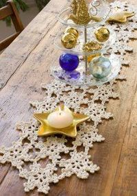 Crochet this Dainty Snowflake Table Runner for the holidays. It's a beautiful centerpiece and would make an excellent hostess gift.