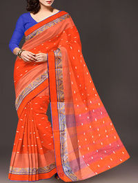 Shop online exclusive pure handloom dhaka cotton tant saree at unnatisilks.com Orange color pure handloom Dhaka cotton tant saree without blouse.This cotton sari has got all over thread weaving bootis along with blue thread woven temple style border on e...