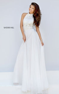 Striking Sherri Hill prom dress 50128 features a beaded bodice and flowing chiffon skirt.A lovely combination of rhinestones and pearl beads embellish the bodice in such an amazing design while the flowing chiffon skirt makes for a fun and easy evening of...