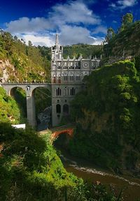 Las Lajas Sanctuary, morning view from across the canyon. From Wikipedia: Las Lajas Sanctuary (in Spanish Santuario de Las Lajas) is a basilica church located i
