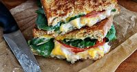 The addition of a creamy white bean spread, tomatoes and spinach kicks up a simple grilled cheese sandwich into something special