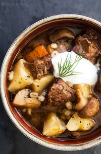 Beef and Barley Stew with Mushrooms Recipe: unsalted butter, beef chuck, salt, onions, cremini mushrooms, beef or chicken broth, dried marjoram, pearl barley, carrot, celery root, pepper, sour cream and fresh dill.