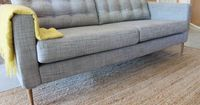 Ikea sofa hack - add mid century legs and tuft the back cushions