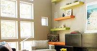 Eighteen-foot ceilings and a wall of windows make the first floor of the Optimists' triplex feel larger than its 576 square feet. Floating shelves and a tangerine orange Sunbrella cushion pop against the neutrals. The coffee table is made from old shi...