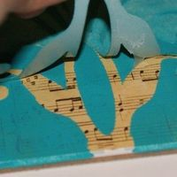 stencil over sheet music - interesting idea... what could I do with this?