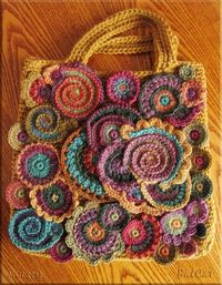 On Grandma's Spinning Wheel - image only, but a great idea for using free-form motifs. At http://grandmaspinningwheel.blogspot.com/2013/05/hand-knitting-is-dreamy-activity-built.html