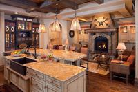 I love the idea of a cozy seating area with fireplace within the kitchen. (Builder: Bridger Builders)