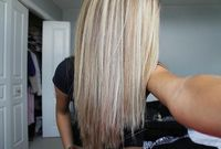 Straightened hair, platinum highlights with medium (ash) blonde lowlights