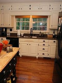 Awesome updated Oak Cabinets to Painted White Cabinets.