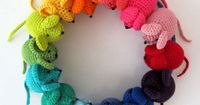 Crocheted Mouse Wreath from Planet Penny. Pattern available. The rainbow colors make it too cute to resist for a child's room.