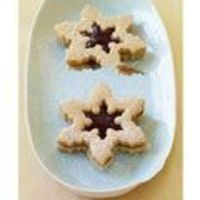 Celebrate the season with these wintry cookies filled with peanut butter and raspberry jam.