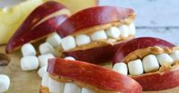 Apple Peanut Butter Teeth are a fun & easy snack the kids will adore, and while this treat is meant for anytime of year, it is especially well suited for Hallow