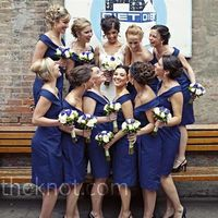 Blue Bridesmaids Dresses The bridesmaids wore retro-style, off-the-shoulder blue Vineyard dresses with simple earrings for a vivid pop of color.