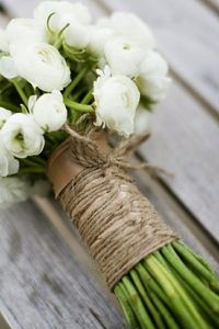 who do i know that is good with flower arranging? to do my bouquet? i like this hemp tie on the stems.. could also be laced up like this with white ribbon or white satin underneath