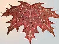 Keep the chill off your shoulders with this beautifully designed and totally functional knitted maple leaf shawl by Ravelry user Natalia