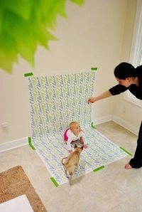 Wrapping paper as a back drop for pictures- great idea, though I won't be needing it for a while :)