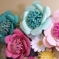 Everyone loves flowers. Especially great big huge pretty flowers! Want to learn how to make huge paper flowers with your Silhouette® machine instead of by hand?