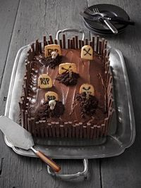 Make a graveyard cake out of a simple pan cake and Milano cookies.