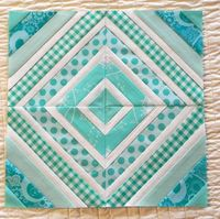 I like that every other strip is white on this string quilt block.