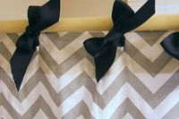 Such a cute idea! Hang curtains (shower or regular) with ribbon instead of hooks or circles! #DIY