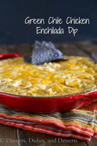 Green Chile Chicken Enchilada Dip - Bubbling hot gooey, cheesy enchilada dip. Turn your favorite green chile chicken enchiladas into a dip perfect for game day.