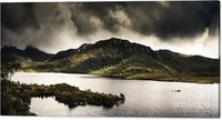 Moody Magnificence Canvas Artwork | Dramatic Tasmania landscape panorama of beautiful Dove Lake with moody storm clouds, Multiple image photostitch taken Cradle Mountain, Tasmania, Australia | #cradlemountain #tasmania #canvaswallart #canvasprints #finear...