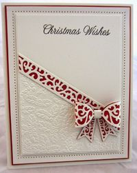 handmade Christmas card from PartiCraft (Participate In Craft) ... white with accents in red ... die cut bow ... diagonal card division ... small holly embossing folder textture ... luv the red backing under the bow ... grear card!