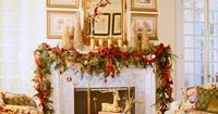 For the holiday season, gold branches and candles and a sprawling swag of greenery highlight the fireplace with festive charm. Ornaments dangle at varying heights, and gold-painted trees stand sentinel at either end of the mantel, playing off the antique ...