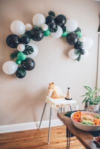 While a jungle first birthday party theme is a popular choice for babies, this mom gave her son's party a modern twist for a fresh new take that we love.