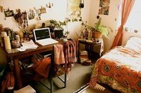 unassuming, cozy bedroom. love the closeness and the peachy-orange colors.