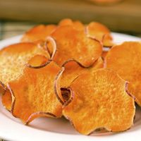 Sweet Potato Chips slice sweet potatoes thinly on a mandolin slicer, toss the slices in one teaspoon of olive oil, lay them out on a cookie sheet, sprinkle them with salt, and bake at 400 degrees for 20-25 minutes, flipping once. Yum!