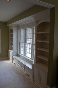 Bookshelves and window seat - current dining room turned part of kitchen :) Cookbooks, fine dishware and collectibles on the shelves - serve ware in the cabinets below. Not sure how this would look with a bay window but a possibility