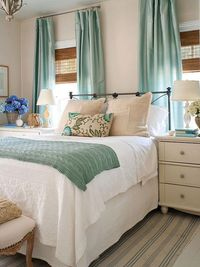 white bedroom with seafoam accents