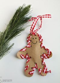 Create an adorable Hand-sewn Gingerbread Ornament with your child with a simple technique. Here's a tutorial on how to make this special handmade ornament.
