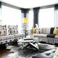 living rooms - charcoal gray grasscloth wallpaper wingback chairs pillows oatmeal linen sofa nailhead trim modern glass-top coffee table black leather modern tufted slipper chair yellow silk pillows black sheers gold plated task floor lamp Kelly Wearstler...