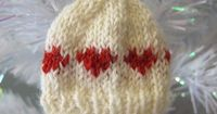 Of all the hundreds of beenies I've made, not once did I think to put hearts in them!