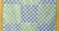 This baby afghan features a boy-friendly checkered design in blue, green and white. Get the free crochet baby afghan pattern here on our website!