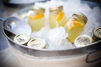 Lemonade mason jars in ice. Such a good idea for a party.
