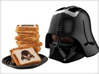 Here's the perfect toaster for you if you like your toasts to be a little on the dark side. AH! See what I did there? That was too easy. The Darth Vader helmet