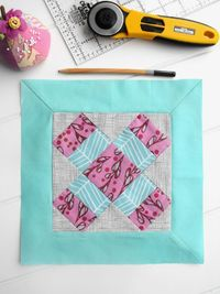 Learn how to sew mitered corners for quilt borders step by step. While it's a challenging border to create, the angled seam is well worth the effort!