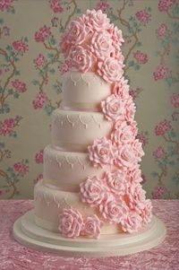 Elegant round five tier white wedding cake with pale pink sugar roses #wedding #cake